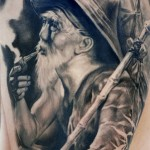 Carlos Torres black portrait tattoo