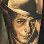 Andy Engel portrait tattoo in black design