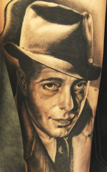 Andy Engel portrait tattoo in black design