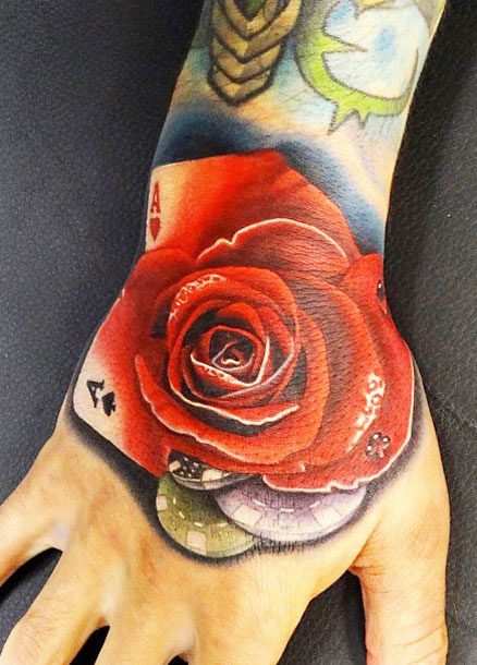 Andres Acosta rose tattoo designed on hand