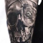 Carlos Torres dark skull tattoo