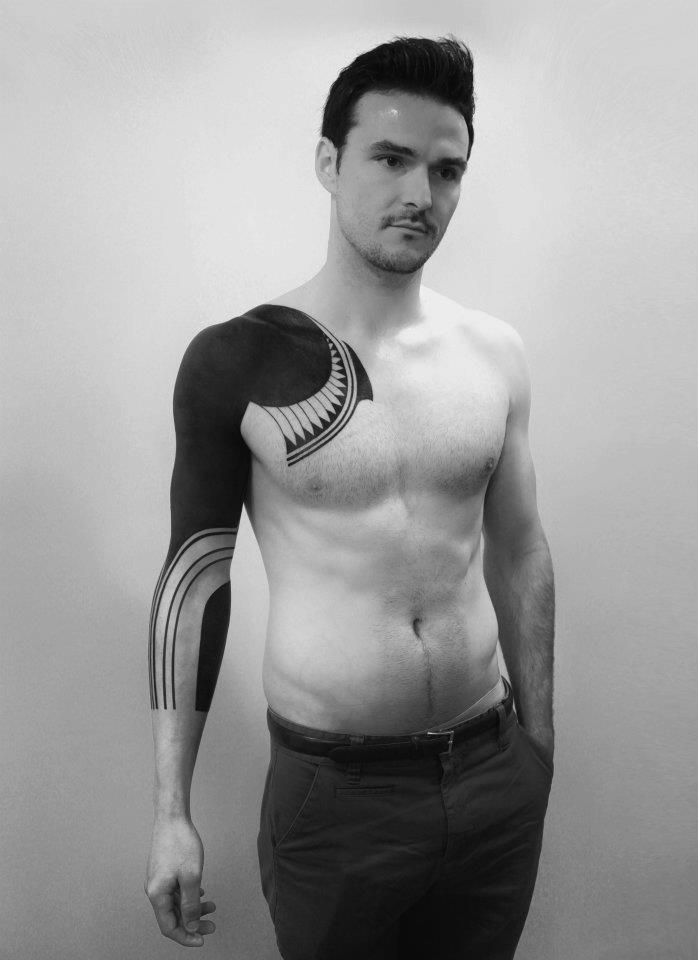 Roxx black tattoo on sleeve and shoulder