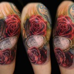 Csaba Kolozsvari rose and clock tattoo