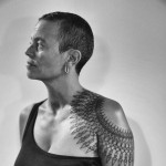 black geometric shoulder tattoo by Roxx