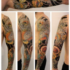 Rob Kelly full sleeve dragon tattoo