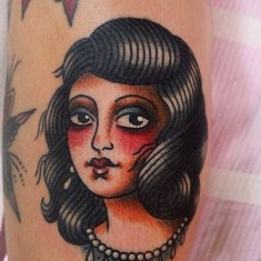 Angelique Houtkamp portrait tattoo on leg