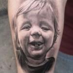 Darwin Enriquez baby tattoo design