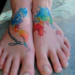 colorful map tattoo on leg