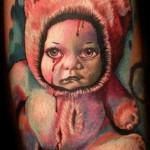 Mario Hartmann baby portrait tattoo