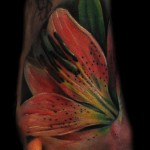 Max Pniewski flower tattoo on leg