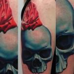 John Anderton red rose and blue skull tattoo