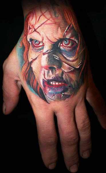 Mario Hartmann scary portrait tattoo design on hand