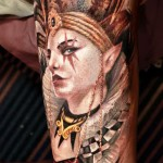 Darwin Enriquez portrait tattoo on sleeve