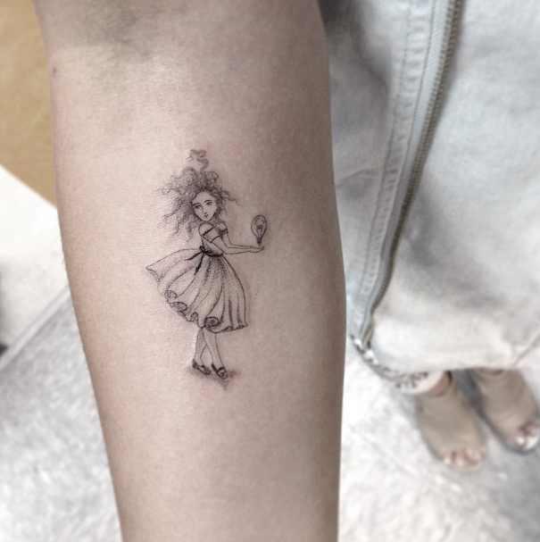 Dr Woo tiny tattoo