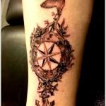 bird and compass tattoo