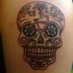 creative skull and bicycle tattoo design