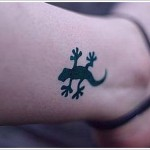tiny lizard tattoo design on wrist