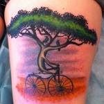 tree and bicycle tattoo design