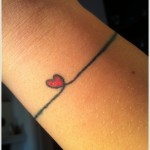 simple heart tattoo on wrost