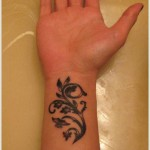 detailed wrist tattoo design for women