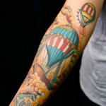 artistic hot air balloon tattoo designed on sleeve