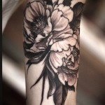 Alice Kendall black ink flower tattoo