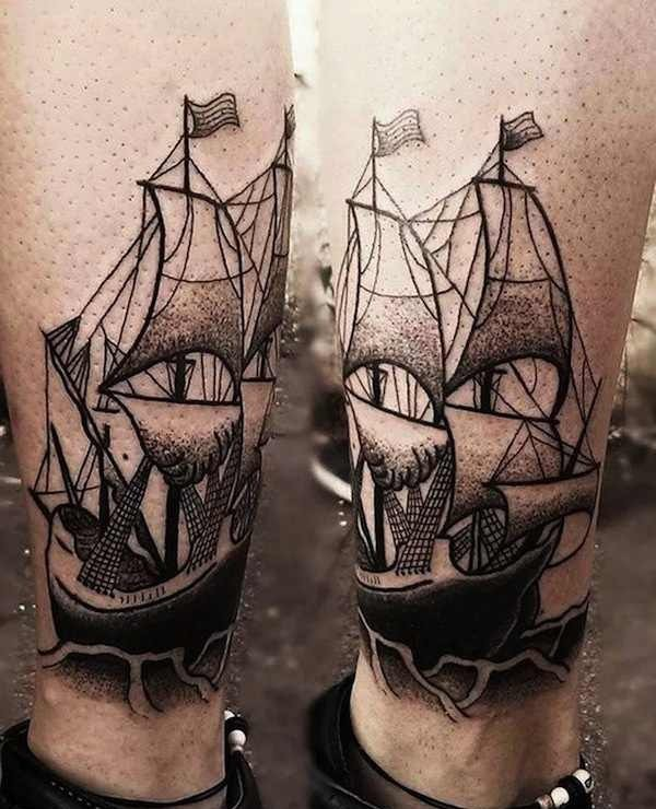 Akaua Pasqual black tattoo on leg