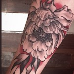 Alice Kendall detailed flower tattoo