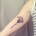 Ana Work feminine flower tattoo