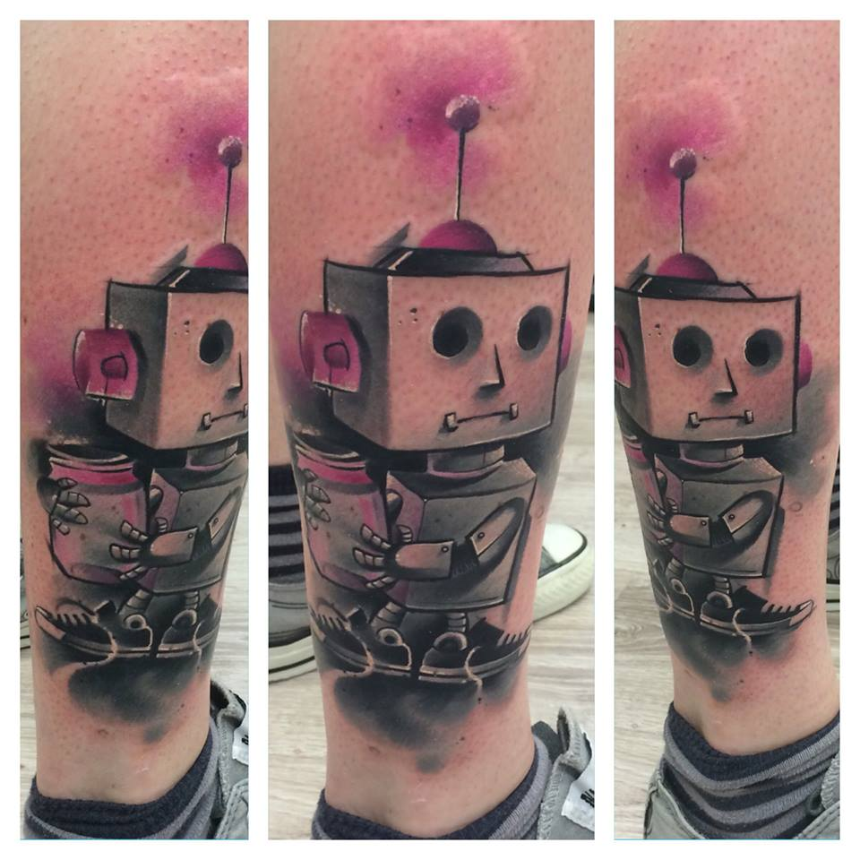 Lukasz Kaczmarek robot tattoo designed on leg