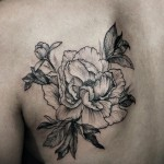 Diana Severinenko black tattoo on back