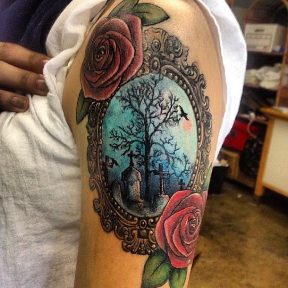 framed cemetery tattoo on sleeve