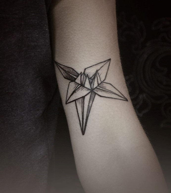 Diana Severinenko simple tattoo on arm