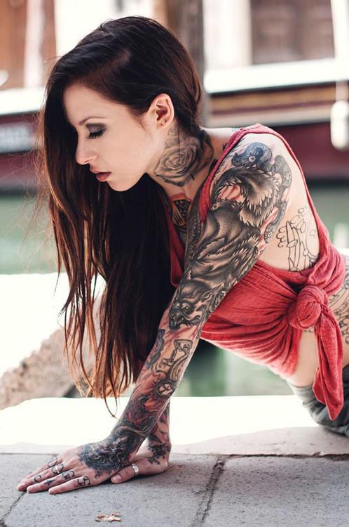 Girl with demon and wolf sleeve tattoo
