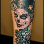 Woman face skull tattoo