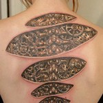 Steampunk tattoo on the back