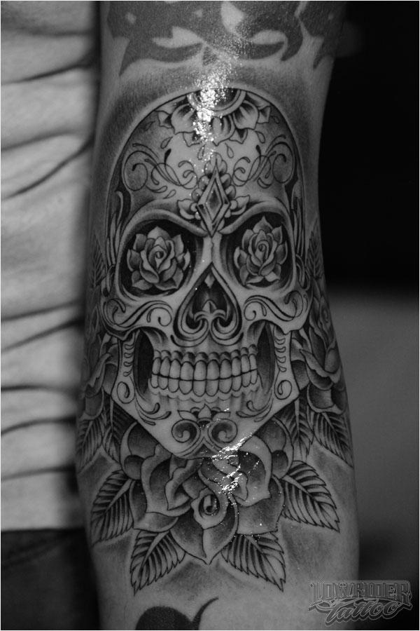 Skull tattoo by Lowridertattoostudios.com