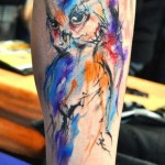 Owl tattoo in abstract style