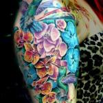 orchids hummingbird tattoo by mirek stotker