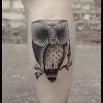 Leg owl tattoo
