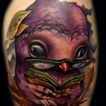 Tattoo with owl reading