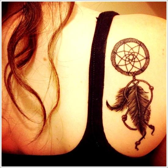 Dreamcatcher tattoo on upper back