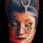 geisha tattoo by Tomasz Tofi Torfinski