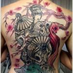 tattoo with geisha and cherry blossom
