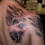 biomechanical tattoo on shoulder