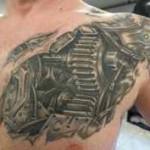 chest biomechanical tattoo