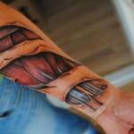 biomechanical tattoo muscle design