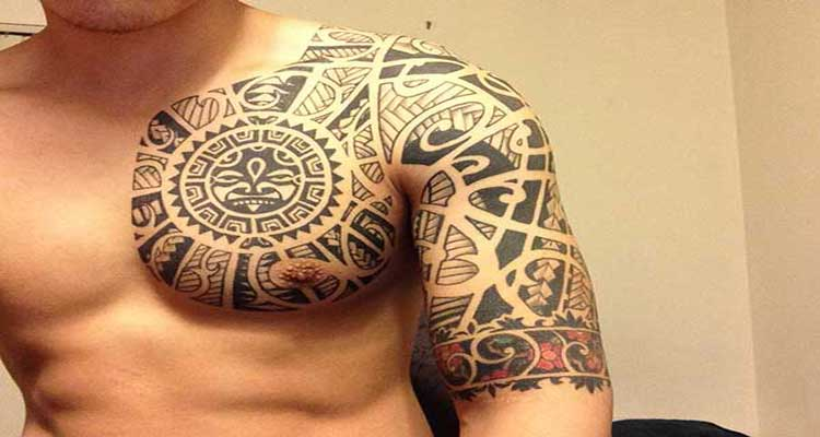 chest and half sleeve tattoo - Design of TattoosDesign of Tattoos