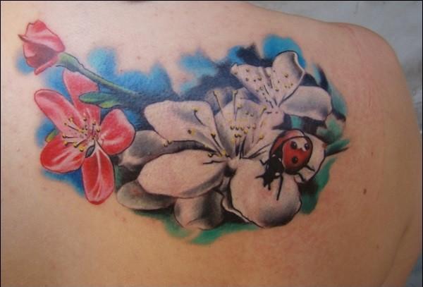 flowers and ladybug tattoo design on back