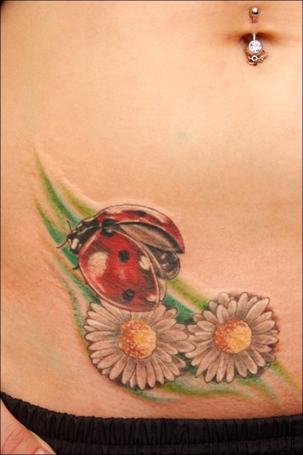 flowers and ladybug tattoo design